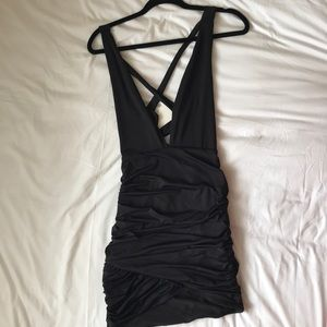 Low plunge black bodycon dress